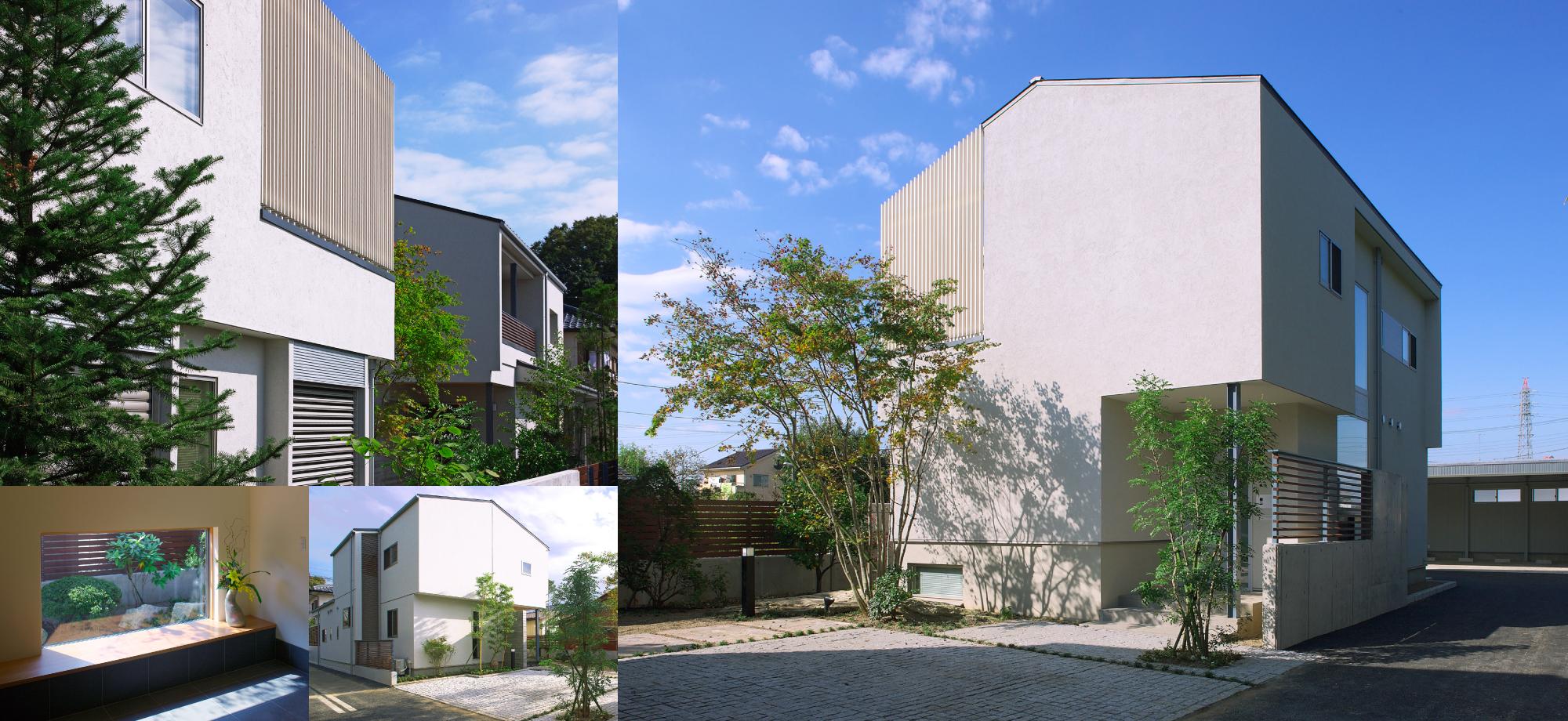 切り妻屋根の対の住まいの画像1